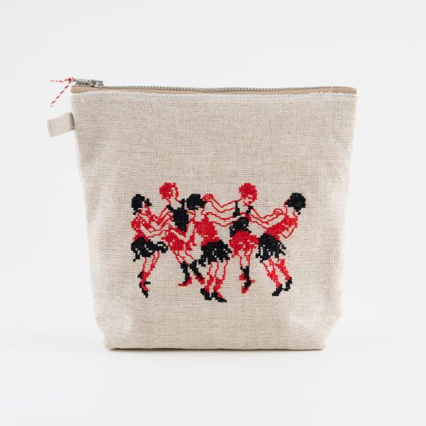 踊る女の子たちが刺繍された、おしゃれなリネンのポーチ
